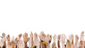 Mãos do grupo de pessoas levantadas Imagens de Stock Royalty Free