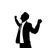 Mãos entusiasmado da posse da silhueta do homem de negócio acima Imagem de Stock
