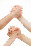 Mãos humanas que demonstram um gesto de uma altercação ou de uma solidariedade Fotos de Stock