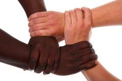 Mãos que mantêm-se unidas firmemente Imagem de Stock