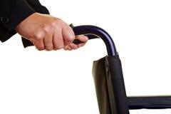 Mãos que prendem o caminhante Foto de Stock Royalty Free