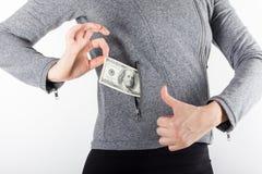 Mãos que prendem o dinheiro Subôrno no bolso dos homens de negócios Dólares da vira-lata Fotografia de Stock Royalty Free