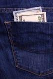 Mãos que prendem o dinheiro Subôrno no bolso dos homens de negócios Dólares da vira-lata Imagens de Stock Royalty Free