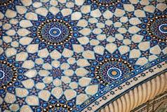 Mosaïque avec Ulugbek Madrasah sur la place de Registan image stock