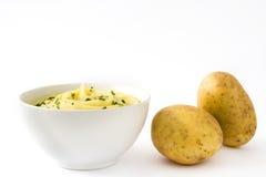 Mosad potatis som isoleras på vit bakgrund royaltyfria bilder