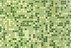 Mosaic. Green and three golden mosaic tiles on the wall Stock Images