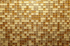 Mosaic. Wall with brown and yellow squares Royalty Free Stock Images