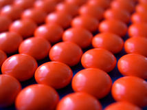 Mosaic 3. Of orange pills stock photo