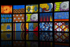 Mosaic of African fabrics, black background Royalty Free Stock Photography