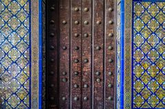 Mosaic and antique wooden door with graffiti in Sevilla Stock Photos