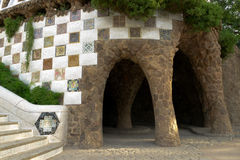 Mosaic and aqueduct. Park Guell mosaic and aqueduct designed by Antonio Gaudi royalty free stock photography