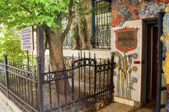 Mosaic around the entrance. Freely accessible for examination of the exposition of mosaic art in the courtyard of residential buildings Stock Image