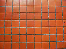 Mosaic background of old tiles in red-brick tone. Stock Image
