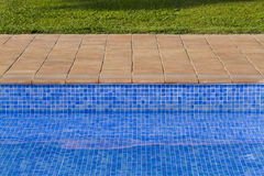 Mosaic background of swimming pool. Mosaic background in the edge of a pool stock photography