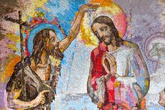 Mosaic of the baptism of Jesus Christ by Saint John the Baptist as the first Luminous mystery. Royalty Free Stock Images