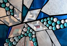 Mosaic. Blue and clear crystal mosaic in a stained glass setting royalty free stock photography
