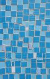 Mosaic of broken tile pieces on wall Stock Photos