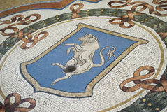Mosaic bull in the floor of the Vittorio Emanuele Gallery, Milan Royalty Free Stock Images