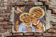 Mosaic on burned church of St. Michael in Stara Sil, Ukraine. Mosaic above the entrance to burned XVII century  church of St. Michael the Archangel  in Stara Sil Royalty Free Stock Photo