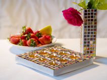 Mosaic candle holder and strawberries Stock Image
