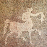 Mosaic of a Centaur holding a rabbit. In the Museum of Rhodes, Greece.This mosaic was created in the 5th Century BC stock images