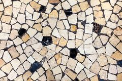 Mosaic ceramic tiles neutral background. Closeup of neutral coloured beige and black abstract mosaic ceramic tiles patterned background stock photo