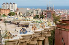 Mosaic colonnade at park Guell and skyline of Barcelona. Mosaic colonnade at Guell park and cityscape of Barcelona. Catalonia, Spain stock image