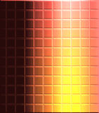 Mosaic of colored tiles. Background composed of a mosaic of small square orange, yellow, and brown tiles Stock Images