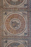 Mosaic decoration of the ruins of ancient Villa Romana del Casale Royalty Free Stock Image