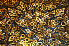 Mosaic with detail of gold blue black flower patten. bangkok, thailand. Mosaic with detail of black gold and blue in lay. bangkok. thailandn Stock Photo