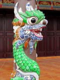Mosaic dragon on a column. Mosaic dragon, Asia. Colorful mosaic of a dragon in emperor tomb. Chinese and vietnam ancient mythological magic creature. a mythical royalty free stock photography