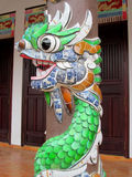 Mosaic dragon on a column. Mosaic dragon, Asia. Colorful mosaic of a dragon in emperor tomb. Chinese and vietnam ancient mythological magic creature. a mythical royalty free stock photos