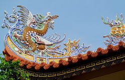 Mosaic dragon on the roof. Mosaic dragon, Asia. Colorful mosaic of a dragon in emperor tomb. Chinese and vietnam ancient mythological magic creature. a mythical royalty free stock photography