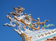 Mosaic dragon on the roof. Mosaic dragon, Asia. Colorful mosaic of a dragon in emperor tomb. Chinese and vietnam ancient mythological magic creature. a mythical royalty free stock image