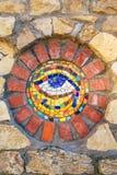 Mosaic Eye of Horus on stone wall. Circular mosaic symbol Eye of Horus on stone wall stock image