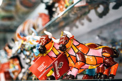 Mosaic figurine of bull in Gaudi style. Spanish traditional gifts in the souvenir shop. Royalty Free Stock Photos