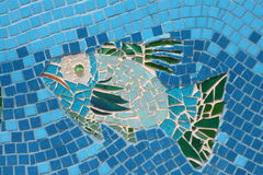 Mosaic Fish 2. Fish made of mosaic and broken tiles and pebbles stock photo