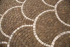Mosaic floor. Brown and white Mosiac patterned floor, Itay Royalty Free Stock Images