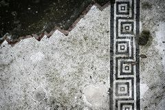 Partly destroyed floor mosaic from Pompei. royalty free stock photography