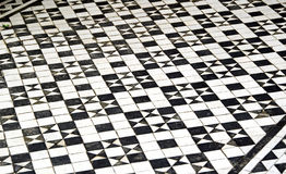 Mosaic floor tiles pattern. Photo of small pieces of black and white mosaic floor tiles in star pattern stock illustration