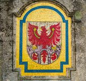 a mosaic that forms Merano& x27;s coat of arms: the red Tirolo& x27;s eagle on the three gates of the city. Royalty Free Stock Images
