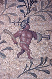 Mosaic gladiator. Ancient Roman mosaic of a gladiator. The mosaic is in the garden of the Villa Sileen, near to Leptis Magna in Tripoli, Libya. The series of royalty free stock photo