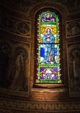 Mosaic glass. The glass mosaic full of colors in an Italian church A illustrates the lives of the saints Stock Photo
