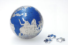 Mosaic Globe. Globe collected from puzzle parts Royalty Free Stock Photos