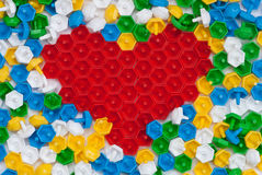 Mosaic heart. Photos of the heart, composed of children's color mosaic Stock Photo