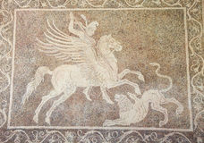 Mosaic of a horseman fighting a lion in Rhodes, Greece Royalty Free Stock Photos