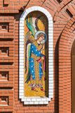 Mosaic icon on the brick wall of orthodox church. Mosaic icon on the brick wall of the orthodox church Royalty Free Stock Photography