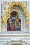 Mosaic icon of the Holy Apostles, Decoration above the entrance. Mosaic icon of the Holy Apostles with geraldic stone carving decoration above the entrance of St Stock Image