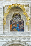 Mosaic icon of the Holy Apostles, Decoration above the entrance. Mosaic icon of the Holy Apostles with geraldic stone carving decoration above the entrance of St Stock Photography