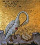 Mosaic on Kykkos Monastery. Pelican feeding her chicks his own blood Stock Image